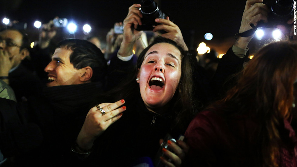 A woman screams as she listens to the announcement that the new pope will be Cardinal Jorge Mario Bergoglio of Argentina.