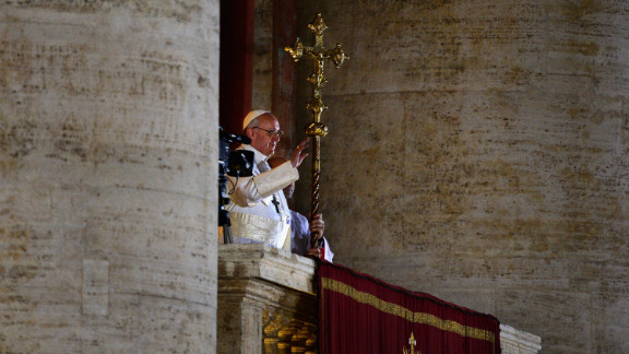Pope Francis waves to the crowd.