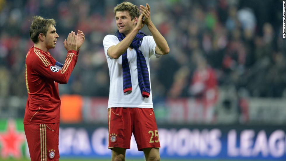 Bayern Munich duo Philipp Lahm and Thomas Muller look relieved after the 2-0 home defeat, a result which takes the German side through on away goals following a 3-3 overall draw.