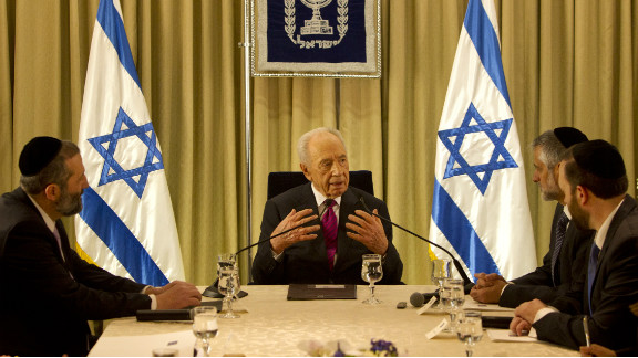 President Shimon Peres (C) sits with Shas Party leaders at the President