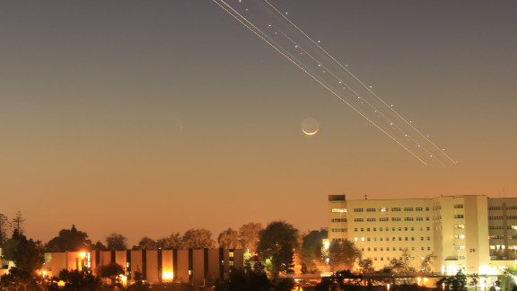 Larry Flynn and his partner were able to see the moon and a passing jet from downtown San Diego, but were not able to see the comet. They were surprised to see it faintly appear in the photo when they returned home.