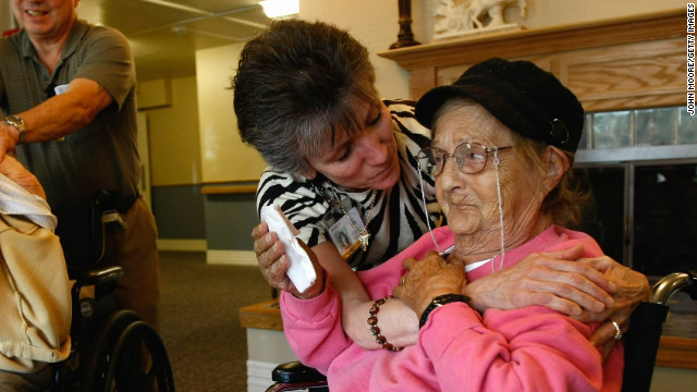 A massage therapist embraces a terminally ill patient at a Colorado hospice.