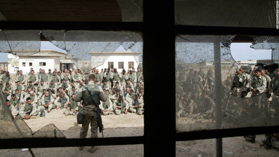 Marines hold a memorial service for friends killed in a battle weeks earlier on April 13, 2003, near Al-Kut, Iraq.