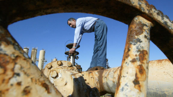 A worker turns a valve at the Shirawa oil field outside the northern city of Kirkuk on January 19, 2004. The security of Iraq