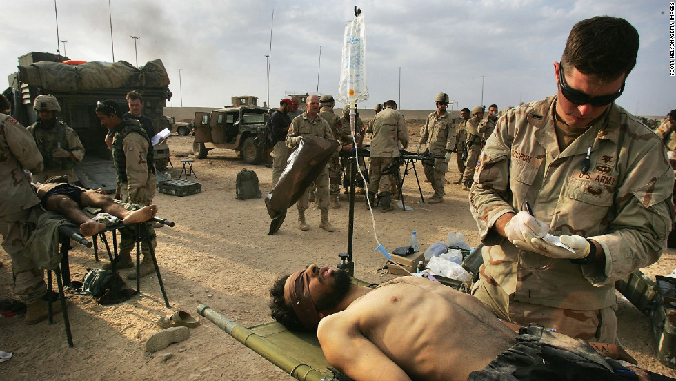 U.S. Army medics treat a wounded Jordanian fighter in Fallujah on November 14, 2004.