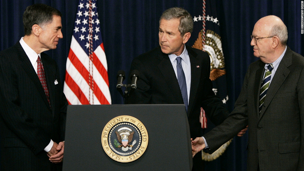 President Bush shakes hands with former Sen. Charles Robb, left, and Judge Laurence Silberman during a news conference in Washington on March 31, 2005. The co-chairmen of the Iraqi Intelligence Commission issued a report indicating that U.S. intelligence agencies were wrong in most pre-war assessments about weapons of mass destruction in Iraq.
