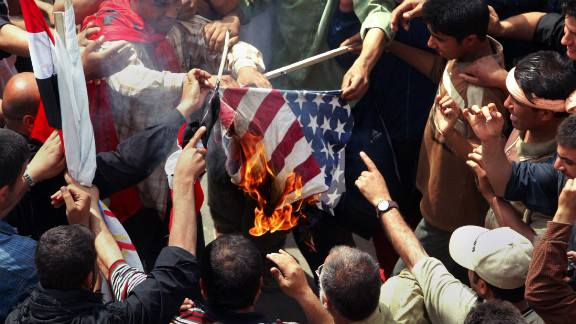 Iraqi Shiite demonstrators loyal to cleric Muqtada al-Sadr burn a U.S. flag during a protest in Baghdad on April 9, 2005. The rally was called on the second anniversary of the fall of Baghdad, with protesters demanding an end to the U.S. military presence in Iraq.