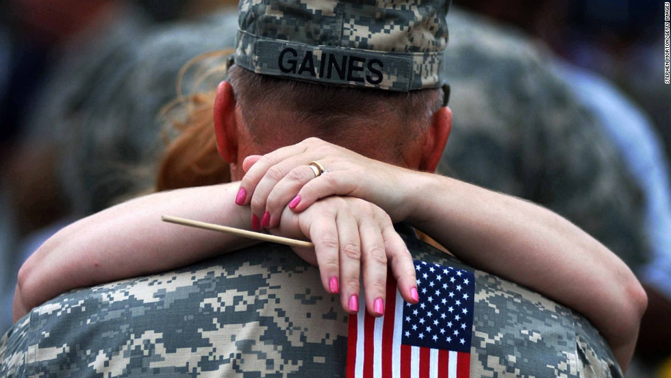 Sgt. Thomas Gaines kisses his wife during a welcome-home ceremony in Fort Stewart, Georgia, on May 11, 2006. About 280 members of the Georgia National Guard 48th Brigade returned home from a year-long deployment to Iraq.