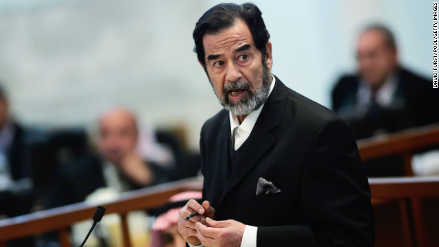 Ousted Iraqi leader Saddam Hussein addresses the court during his trial in the heavily fortified Green Zone October 17, 2006, in Baghdad, Iraq. (Photo by David Furst-Pool/Getty Images)