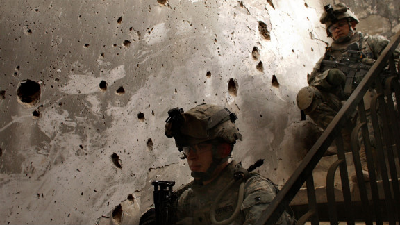 U.S. soldiers sit in a home damaged by fighting in Baghdad on March 11, 2008, near the five-year anniversary of the war.