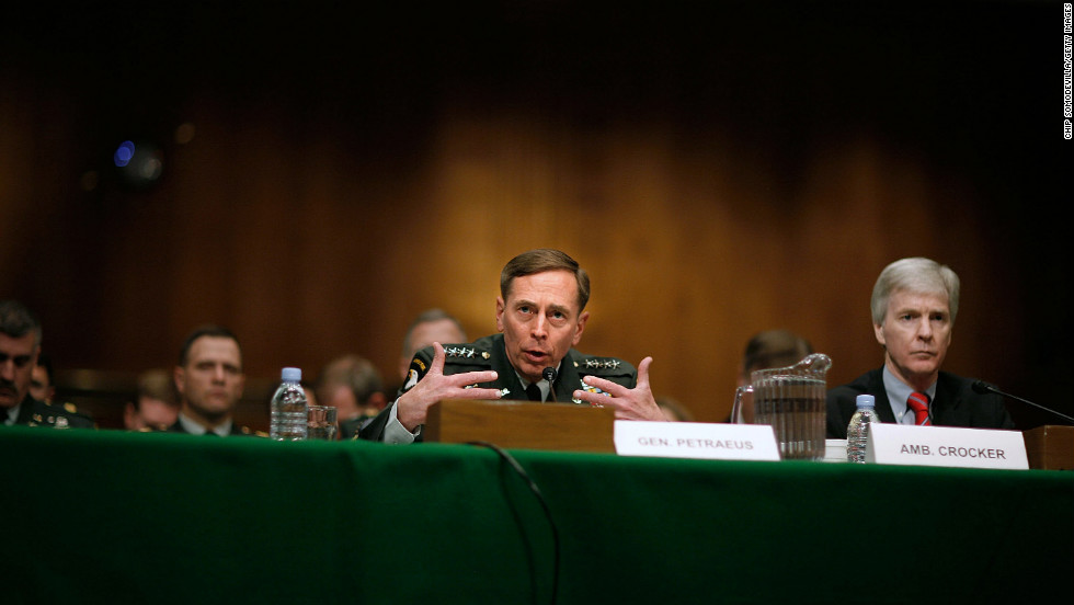 Commanding Gen. David Petraeus, center, and Ambassador Ryan Crocker testify before the Senate Armed Services Committee in Washington on April 8, 2008. In reporting on the success of the surge in Iraq, Petraeus said the number of U.S. troops in the country should not drop below 140,000.