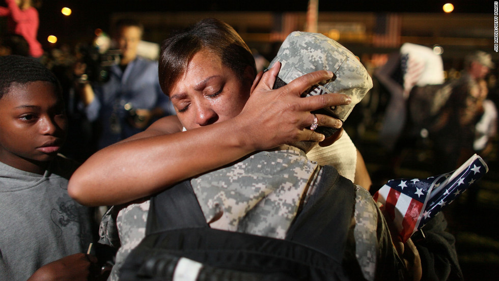 Army Sgt. Donald Lewis from the 1st Cavalry Division is greeted by his wife, Nicole Lewis, after his brigade arrived home in Fort Hood, Texas, on November 10, 2009, after a year of deployment in Iraq.