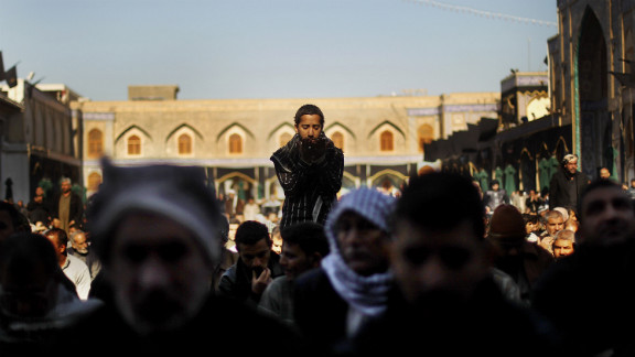 Shiite worshipers pray during an Ashura commemoration ceremony at the Kadhimiya shrine in Baghdad on December 6, 2011. Ashura marks the death of Prophet Mohammed
