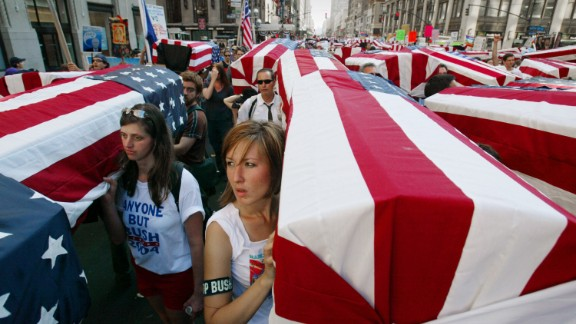 Anti-war protesters in New York carry mock coffins draped with U.S. flags on August 29, 2004. Thousands took part in demonstrations outside Madison Square Garden on the eve of the Republican National Convention.