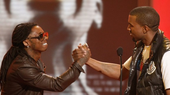 Rapper Lil Wayne, left, congratulates Kanye West on his Best Male Hip Hop Artist win onstage during the 2008 BET Awards at the Shrine Auditorium on June 24, 2008, in Los Angeles.