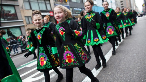 Young girls don Irish-inspired dresses as they participate in New York City