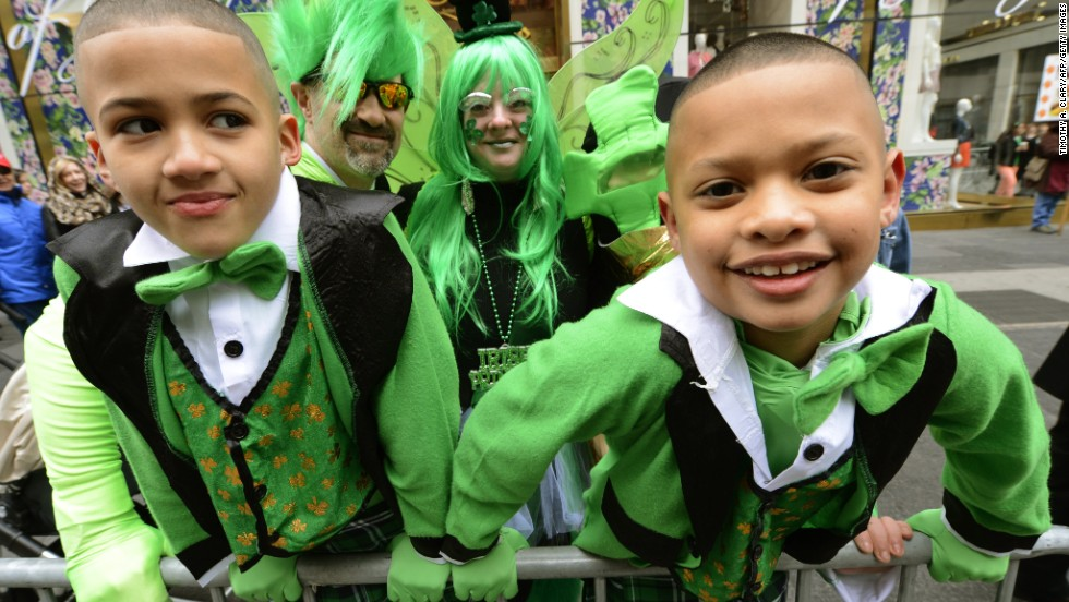 Jordan and Jadin Frazier look on as New York City's annual St. Patrick's Day Parade makes its way up Fifth  Avenue on March 16.