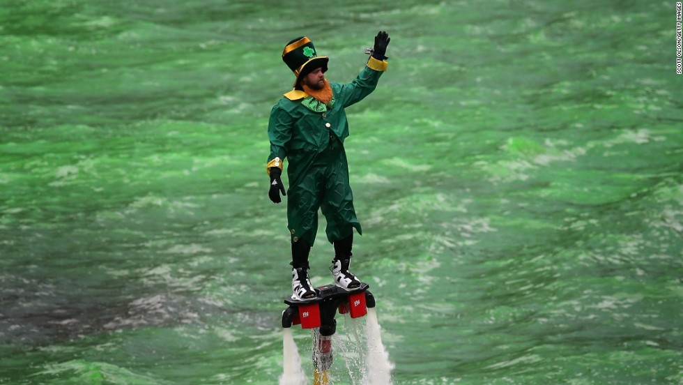 A man dressed as a leprechaun waves to the crowd on a water-propelled Flyboard in the green-dyed Chicago River during the city's St. Patrick's Day celebration on March 16.