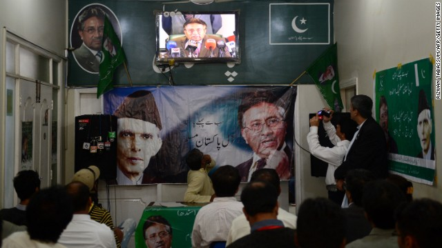 Activists of the All Pakistan Muslim League (APML) watch former president Musharraf give a press conference March 1, 2013.