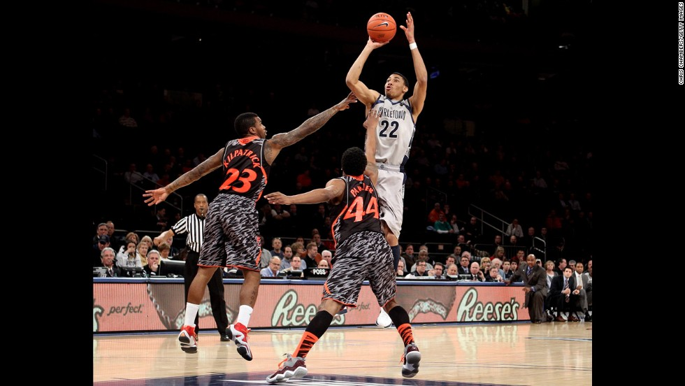 Yes, Notre Dame is dominating the ugly-uniform conversation these days, but it's hard to ignore the Cincinnati Bearcats' fierce stripes. Well, a deer in the wild might. Cincinnati's Sean Kilpatrick and JaQuon Parker defend Otto Porter Jr. of the Georgetown Hoyas in their quarterfinal game March 14. Meow?