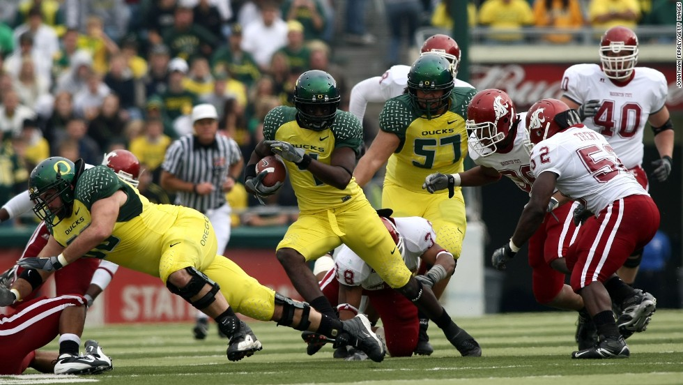 Maybe ducklings will always be ugly.  The University of Oregon Ducks don highlighter yellow jerseys with patterned green shoulders in their game against the Washington State Cougars, October 2007.