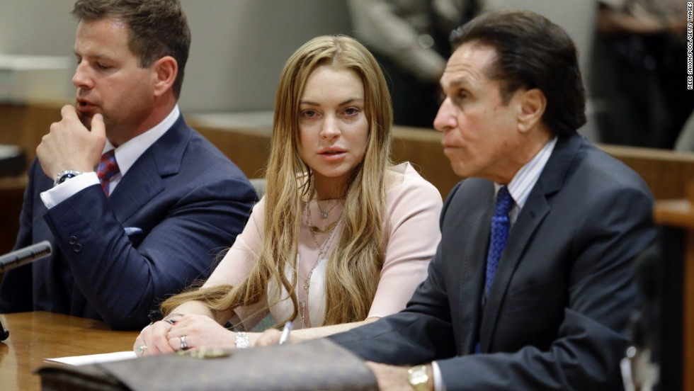 Lohan appears in court with her attorneys Anthony Falangetti, left, and Mark Heller in Los Angeles in March 2013. She entered pleas of no contest on two misdemeanor charges relating to a 2012 traffic accident, and she did not challenge the finding that she violated her shoplifting probation with those convictions.