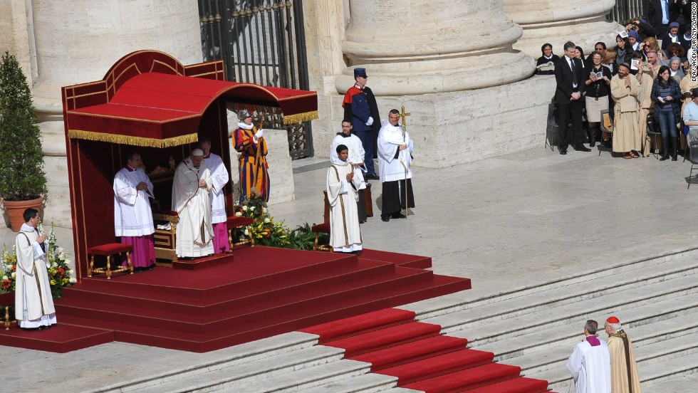 Francis prays during his inauguration Mass in St. Peter's Square on March 19.
