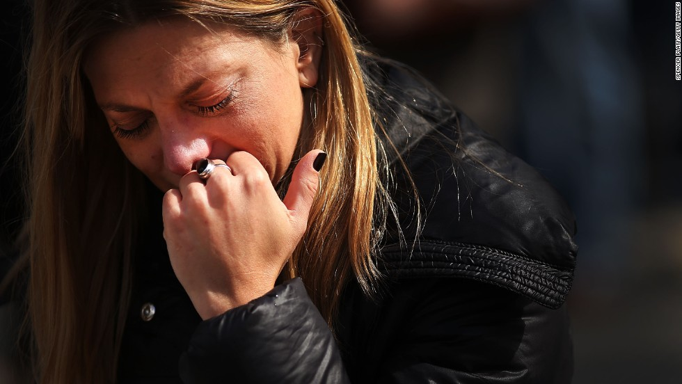 A woman prays during the inauguration Mass at St. Peter's Square.