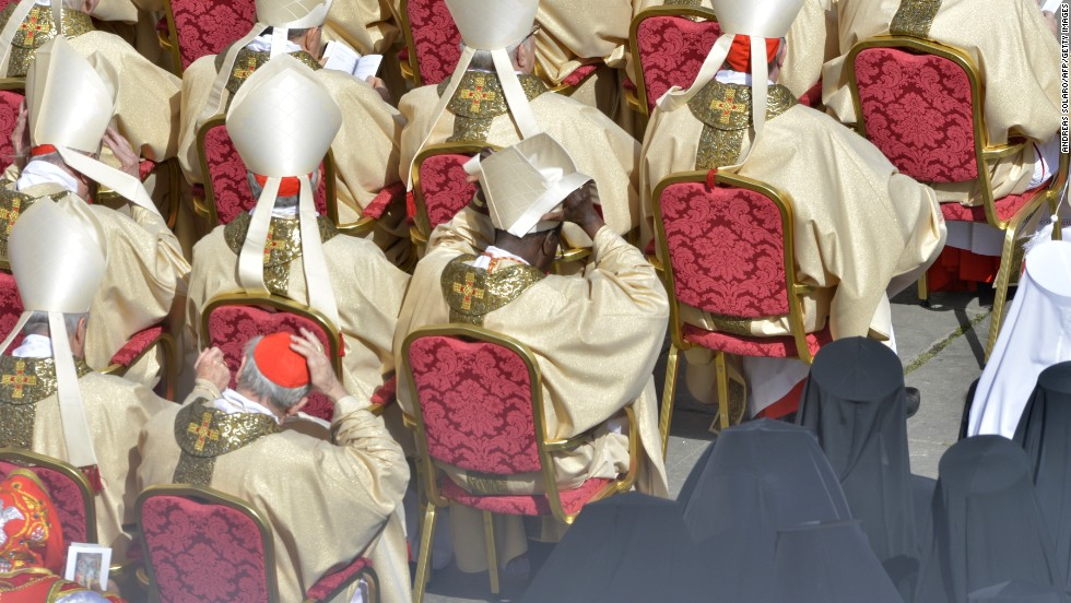Cardinals attend the ceremony in which Latin America's first pontiff received the formal symbols of papal power.