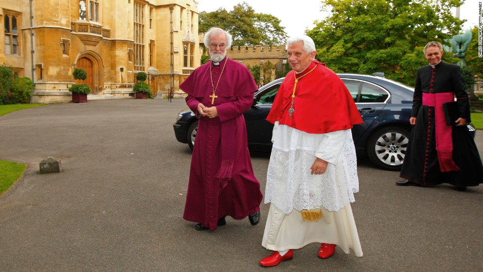 "Rowan Williams, the archbishop of Canterbury, left, greets Pope Benedict XVI at his official residence, Lambeth Palace, in central London in September 2010.  Here, Benedict XVI wears a mozzetta, a cape worn by the pope and some other religious leaders. ""The winter one matches the camauro because it is also red velvet or wool and adorned with ermine,"" Beck said. ""This was also brought back by Benedict XVI after having fallen into disuse. There's also a white summer version."""