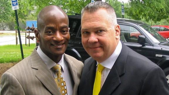 Scott J. Hamilton, right, and his husband, Wayne C. Johnson.
