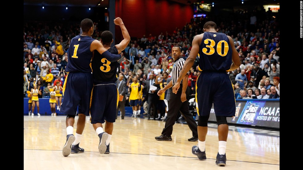 From left: Adrian Powell, Jeremy Underwood and Lamont Middleton of the North Carolina A&T Aggies celebrate after beating the Liberty Flames 73-72 during their First Four round on March 19 in Dayton. The Aggies will face No. 1 seeded Louisville on March 21.