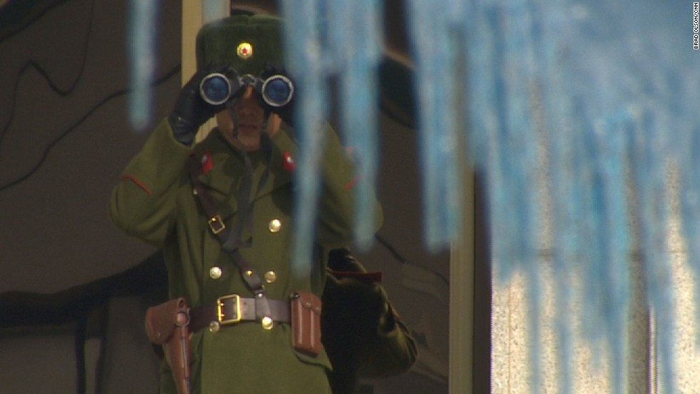 One North Korean soldier observes us closely with his binoculars through the icicles.