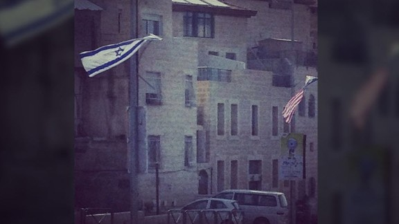 """Israeli and U.S. flags flying side-by-side can be seen all across Jerusalem with banners boasting of the """"unbreakable alliance"""" with the United States."""