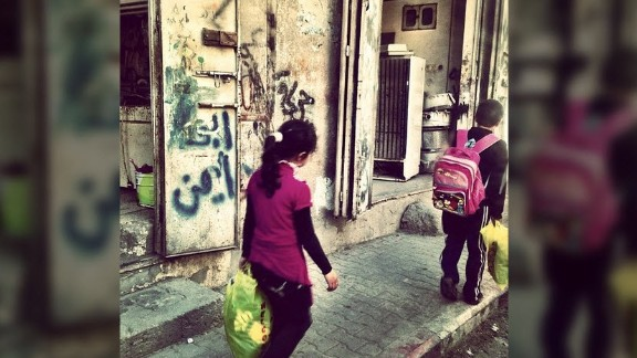 Children walk home from school in Gaza. In addition to Israel, Obama is also visiting the West Bank and Jordan, but not Gaza.