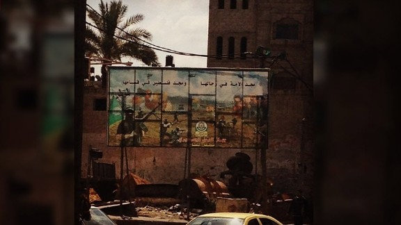 In Gazy City, a billboard celebrates a Hamas militant wing.