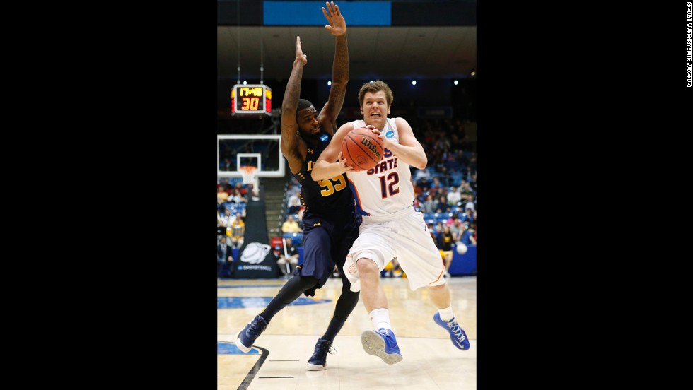 Igor Hadziomerovic of Boise State drives to the basket against Ramon Galloway of La Salle on March 20.