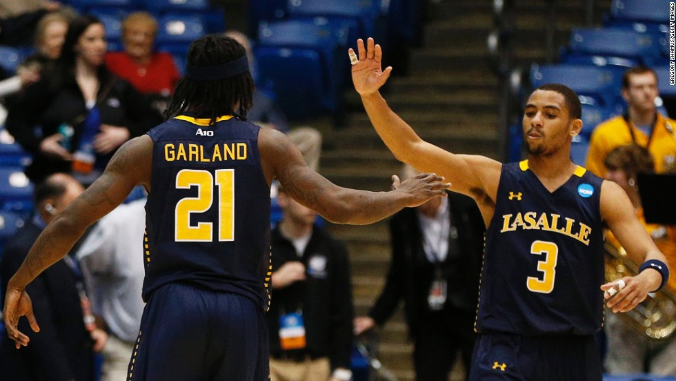 Tyrone Garland and Tyreek Duren of the La Salle Explorers celebrate after defeating the Boise State Broncos 80-71 during the First Four round of the NCAA tournament on Wednesday, March 20, in Dayton, Ohio. Check back to follow the action and see the results as March Madness unfolds.