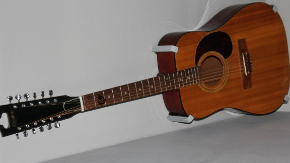 """With the popularity of guitar bands like the Beatles and Rolling Stones, Bowie soon took up the guitar. He played this 12-string Harptone acoustic on his first breakthrough hit, """"Space Oddity"""" in 1969."""
