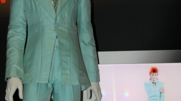 """Bowie wore this ice blue suit by Freddie Burretti for the 1972 """"Life on Mars"""" promotional film with Japanese eyeshadow applied by make-up artist Pierre Laroche. """"For weeks my stage persona went all geisha,"""" the singer said."""