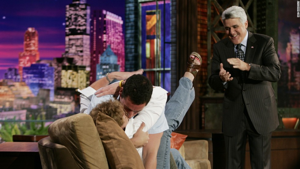 Actor Adam Sander gets hot and heavy with audience member Sharon Kidd of Rogers, Arizona, on September 15, 2005.