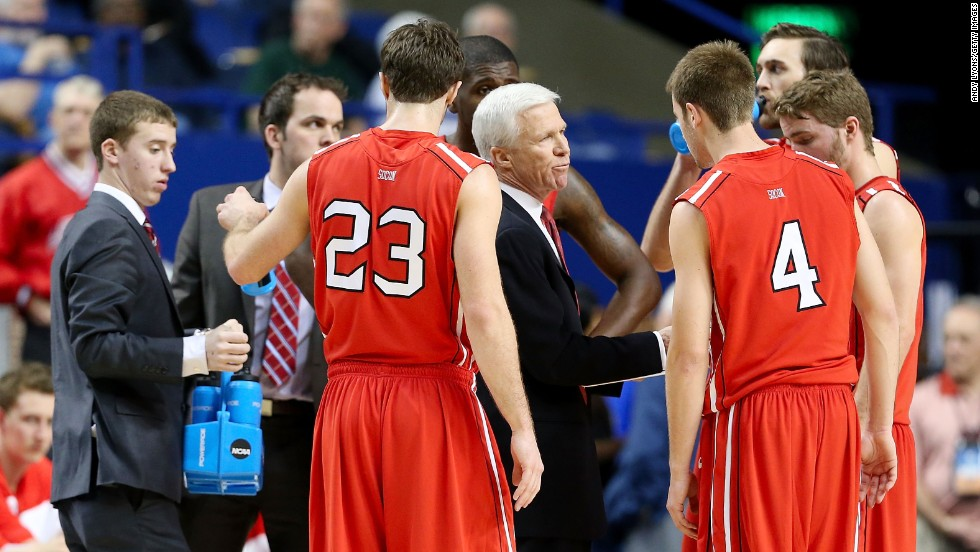 Davidson head coach Bob McKillop talks with his team in the first half of the March 21 game against Marquette.