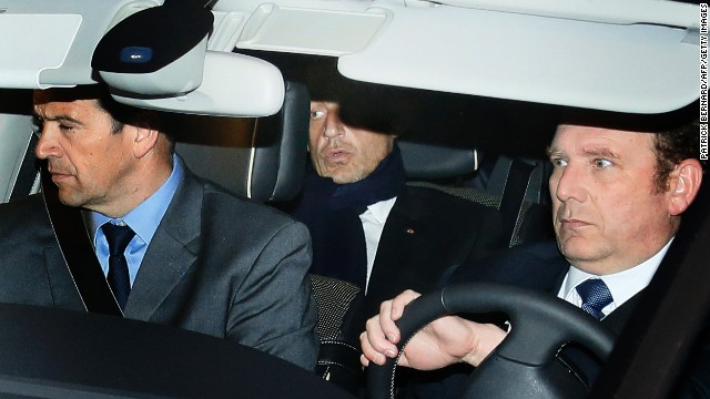 Former French president Nicolas Sarkozy (C) leaves Bordeaux' courthouse on March 21, 2013.