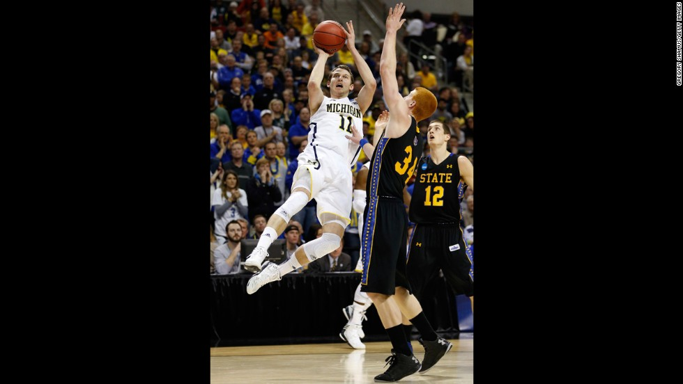 Nik Stauskas of Michigan takes a shot over Tony Fiegen of South Dakota State on March 21.
