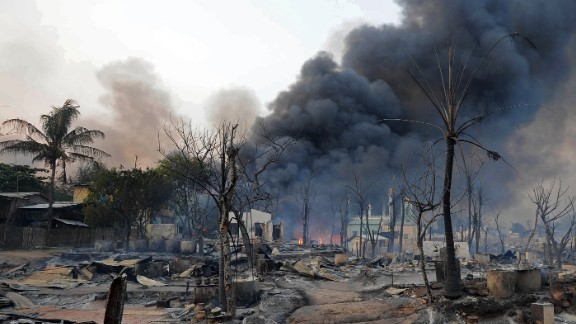 Smoke rises from burning houses around a mosque in riot-hit Meiktila, central Myanmar on Thursday.