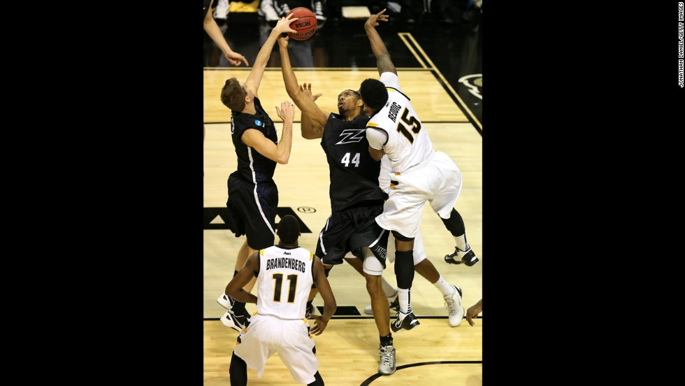 Zeke Marshall, center, and Brian Walsh, left, of Akron fight for a rebound against Juvonte Reddic of VCU on March 21.