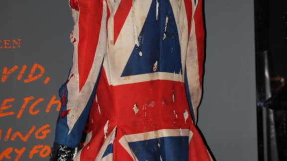 """Bowie wears this Union Jack coat he co-designed with Alexander McQueen -- then a relatively unknown designer -- for the """"Earthling"""" album of 1997. He faces away from the camera in the photo, in contrast to all his other album covers, although his Ziggy-style haircut is still recognizable."""