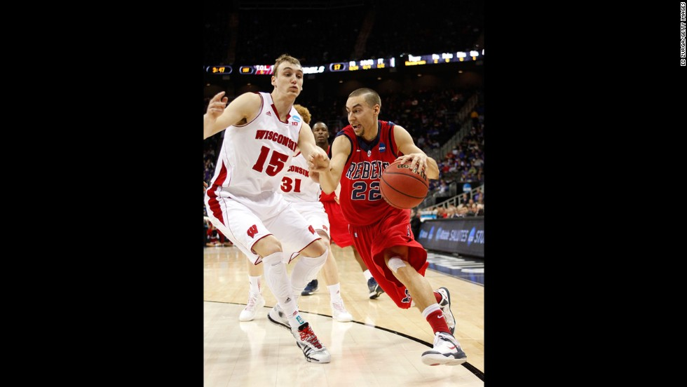 Marshall Henderson of the Ole Miss Rebels, right, drives against Sam Dekker of the Wisconsin Badgers on March 22.