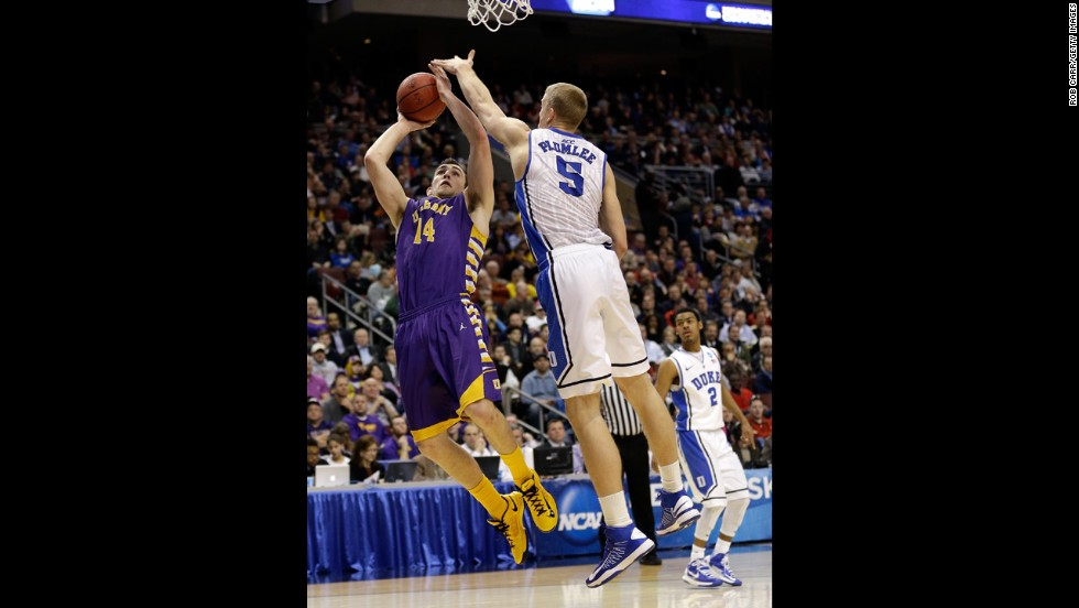 Sam Rowley of the Albany Great Danes, left, shoots over Mason Plumlee of the Duke Blue Devils on March 22.