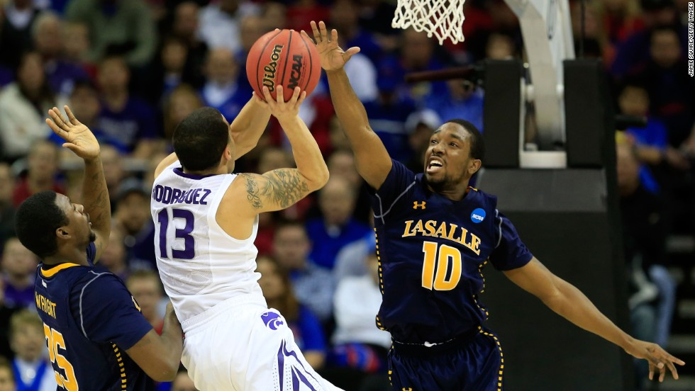 Angel Rodriguez of the Kansas State Wildcats, second from left, shoots against Jerrell Wright, left, and Sam Mills of the La Salle Explorers on March 22.